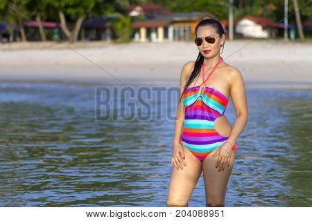 Woman shape beautiful with bikini morning on beach at Thung Wua Lan Beach Chumphon Province Thailand