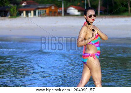 Woman sexy with bikini morning on beach at Thung Wua Lan Beach Chumphon Province Thailand