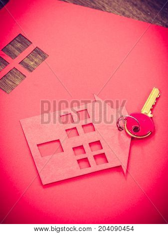 Security ownership property accesst real estate concept. House cutout with keys. Home symbols lying on floor.