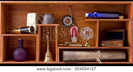 Items for travel and adventure on a wooden shelf