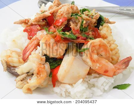 Fried basil leave with combination on rice