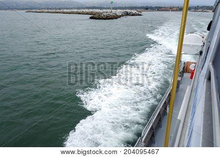 City and Ventura harbor as seen from a cruise ship heading into the ocean Southern California
