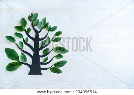beautiful fantasy symbolic tree . Symbol of peace and family. Environment,  forest restoration , ecosystem, ecology. Background with space for text