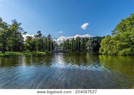 ST.PETERSBURG/RUSSIA - JULY 26, 2017. Marble bridge in the landscape part of the Catherine Park of Tsarskoye Selo