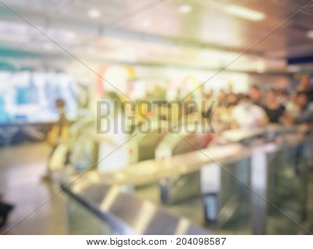 Blurred Image Of Passengers Go Through The Subway Train Station Ticket Barriers.  Asian People Waiti