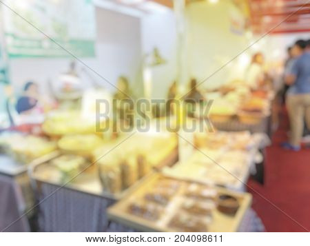 Blurred Image Background Of People Eating In The Street Food Restaurant Or Food Shop And Order Some