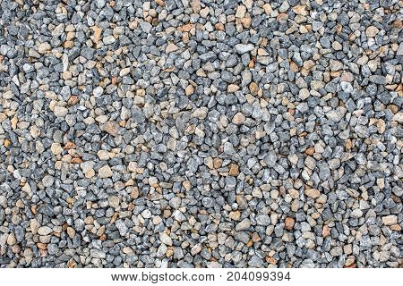 a dark gray crushed gravel texture for background
