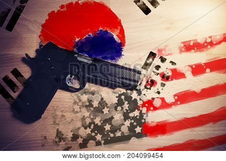 Relations between countries. America and South Korea flag paint on wood background with gun weapon between two flags.