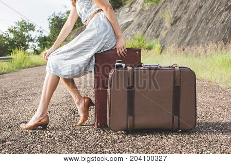 woman traveller with vintage lugguage in retro color