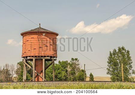 Built by a railroad company the red water tank stored water for steam engines.