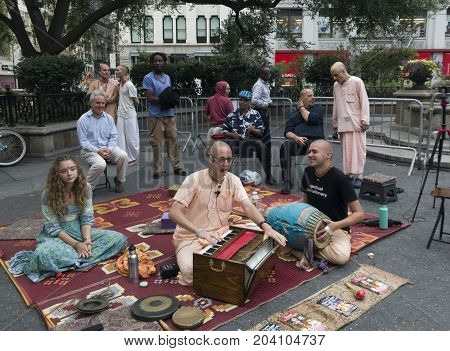 NEW YORK NEW YORK USA - AUGUST 25: Hare Krishna people chant on 14th street and Union Square NYC. Taken August 25 2017 in New York.