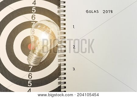 lightbulb on dartboard. concept goal 2018 for new ideas with innovation and creativity.