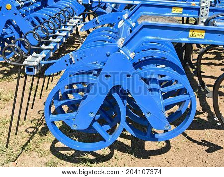 Part of the harrow machinery outdoor in summer