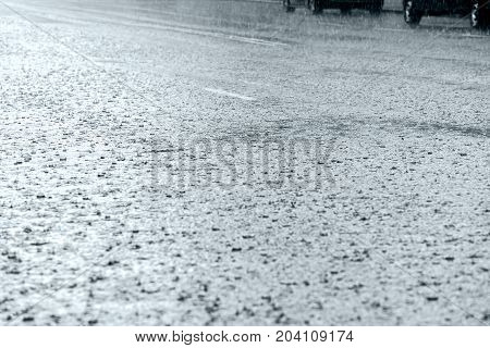 Flooded Road With Raindrops During Heavy Rain