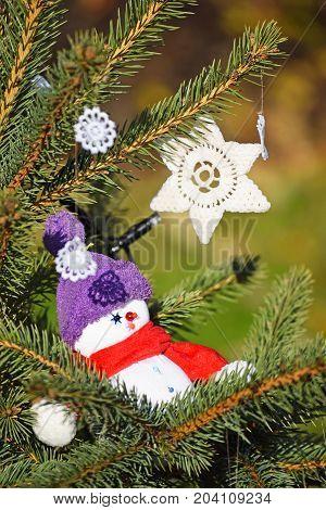 Snow man figurine in the christmas tree