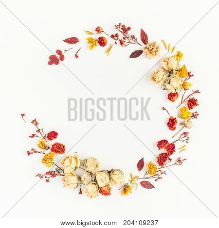 Autumn composition. Wreath made of autumn dried leaves and flowers. Flat lay top view copy space square