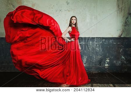 Beautiful Fashion Girl Wearing Red Evening Gown on Vintage Background