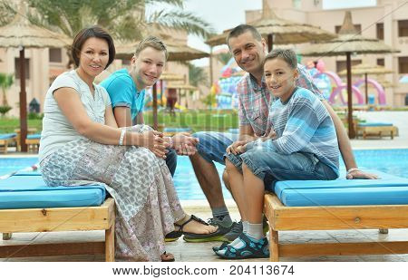 Portrait of a happy family at resort