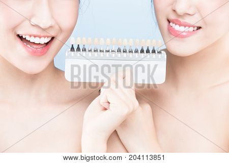 two beauty woman with tooth whiten concept on the blue background