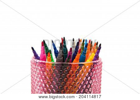 Group of color felt-tipped pens in a glass white background