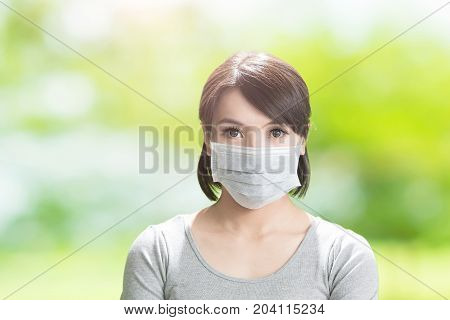woman feel sick on the green background