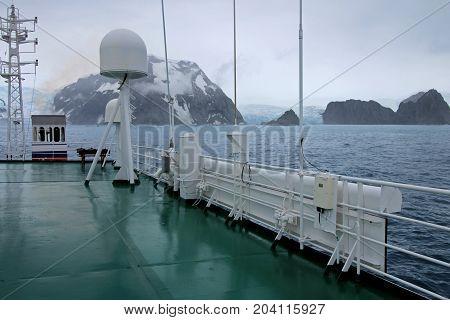 Mountains and glaciar, view from cruise ship, Antarctic Peninsula, Antarctica