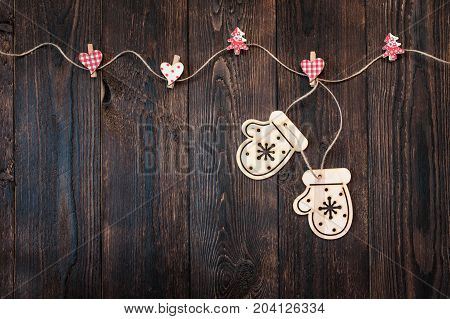 Dark wooden texture and Christmas toys in the form of mittens and place for text