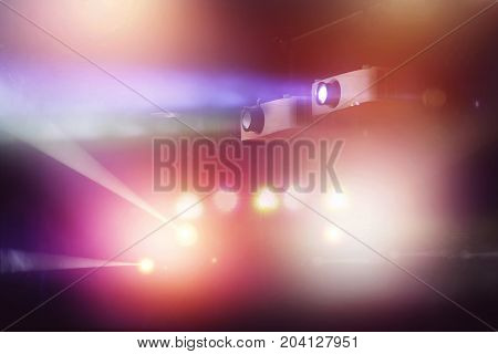 video projector in nightclub and colorful light beam