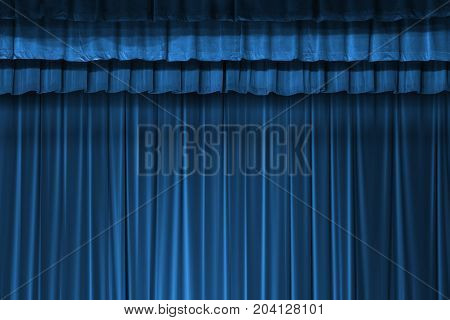 dark shadow in blue fabric curtain in theater