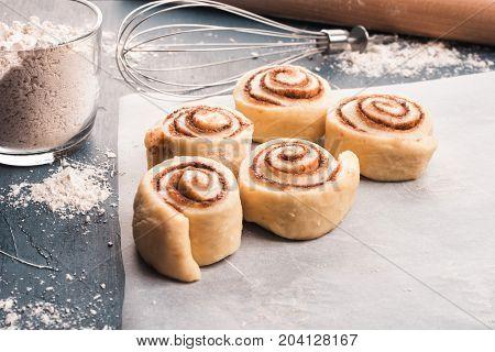 Raw Cinnamon Rolls Dough On Table.