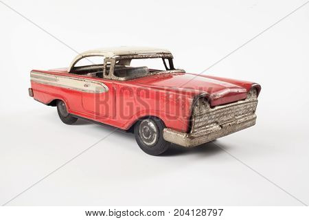 Vintage toy red metal car isolated on white
