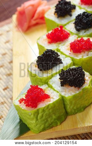 Japanese sushi . traditional japanese food.Roll made of Smoked fish and roe