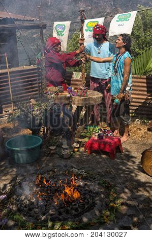 January 31 2015 San Pedro la Laguna Guatemala: Mayan men performing shamanic ritual next to fire
