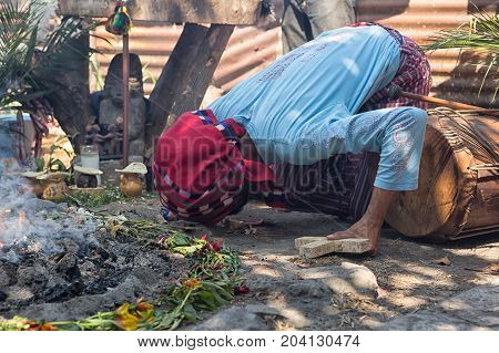 January 31 2015 San Pedro la Laguna Guatemala: Mayan man performing shamanic ritual next to fire
