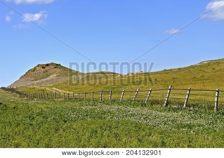 Fence line forms boundary of the north unit of the North Dakota Badlands