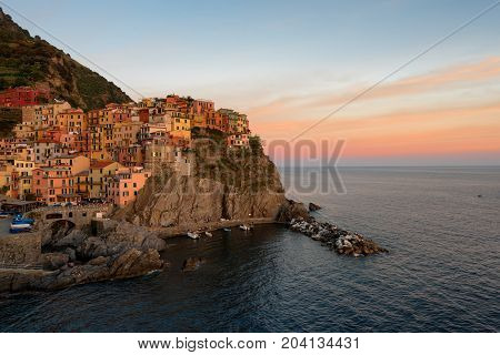 Magnificent sunset view of the Manarola village. Manarola is one of the five famous villages in Cinque Terre (Five lands) National Park. Liguria, Italy, Europe
