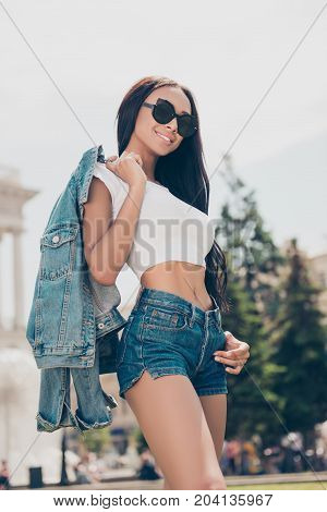 Attractive Carefree Gorgeous Lady With Bronze Skin Is Posing In Sunny Town, On Stroll, In Eyewear, W