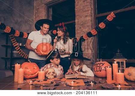 Candies Time! Attractive Mom Is With Bowl Of Yummy Gummy Worms For Her Small Siblings Who Are Occupi