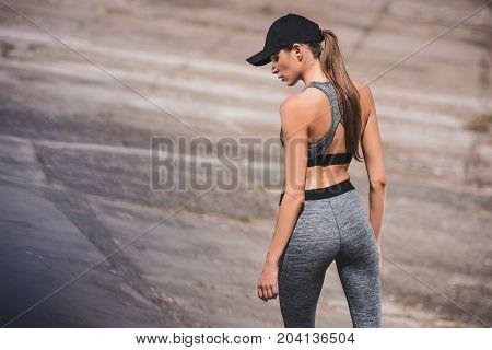 Woman In Sportswear And Cap