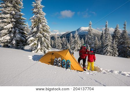 Romantic Couple During The Winter Travel In Wilderness