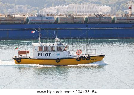 Varna Bulgaria - September 30 2014: Yellow and white small pilot boat enters the port