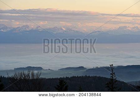 Autumn fog over Lake Geneva French Alps behind Nyon Switzerland