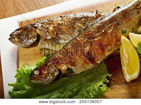 Two grilled Rainbow Trouts.Served with Vegetables closeu p   meal