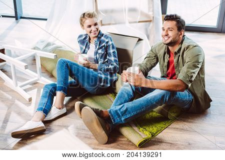 Couple Drinking Tea In New Apartment