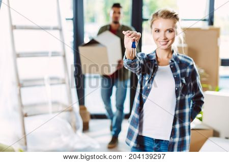 Couple With Keys In New House