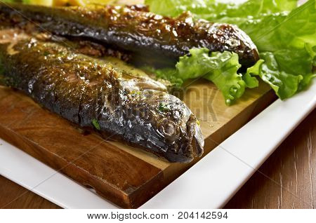 Two grilled Rainbow Trouts.Served with Vegetables  , close up traditional meal