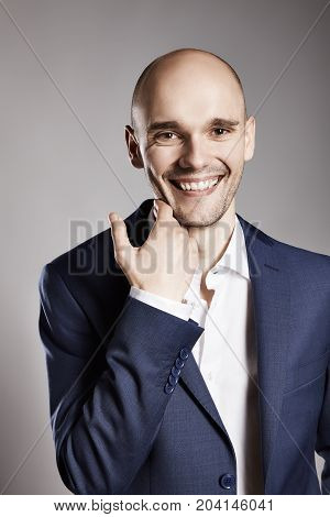 Cheerful Man Stroking His Chin