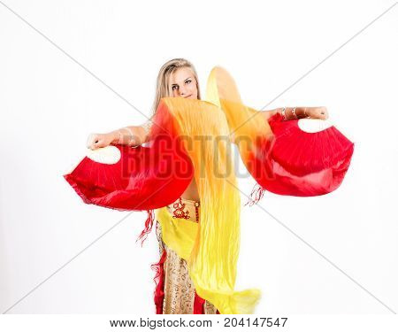 Arabic dance with fans and ribbons performed by a beautiful plump woman.