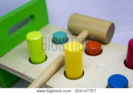 Wooden toy for kid's for muscle practice by hitting