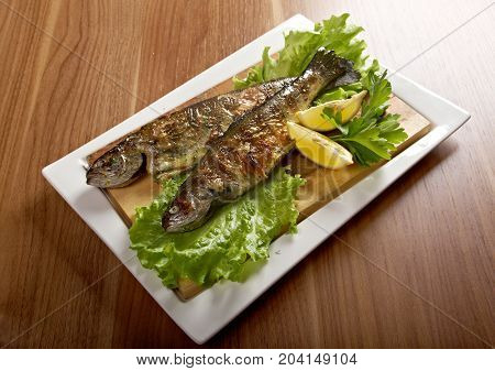 Two grilled Rainbow Trouts.Served with Vegetables  close up traditional meal